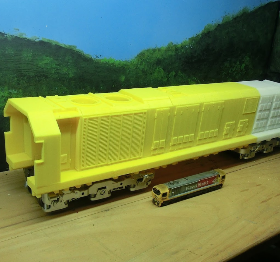 3d Printed Train Side By Side Comparison With Small Model